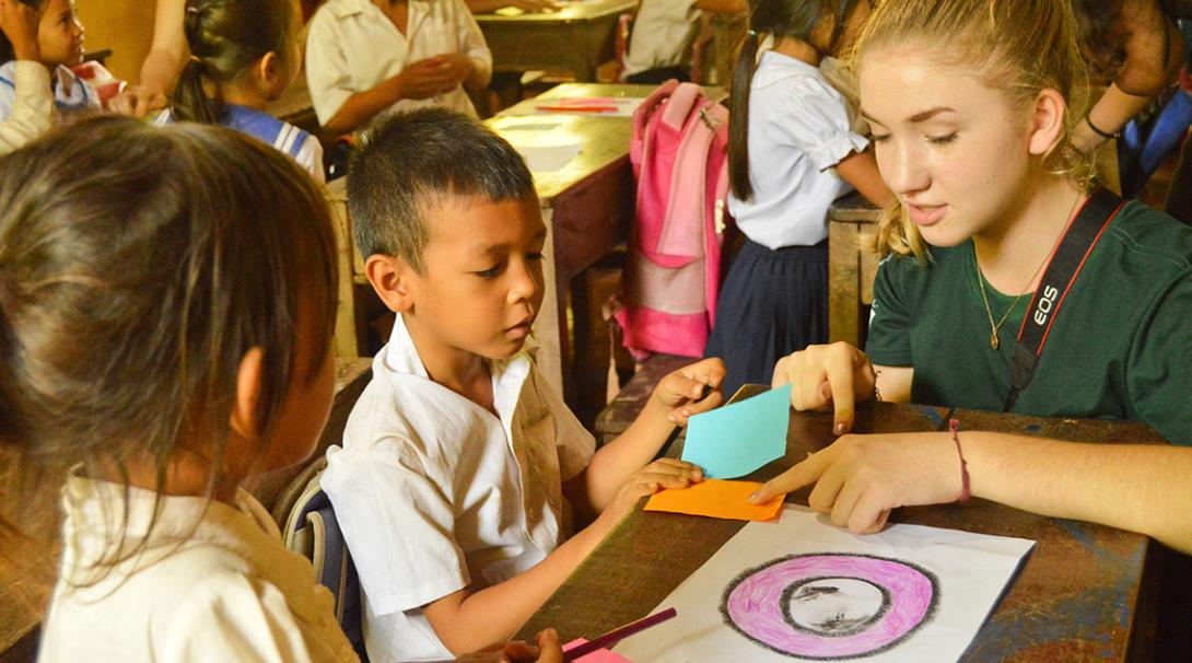 A volunteer working with children in Cambodia organises fun activities at a local community centre.